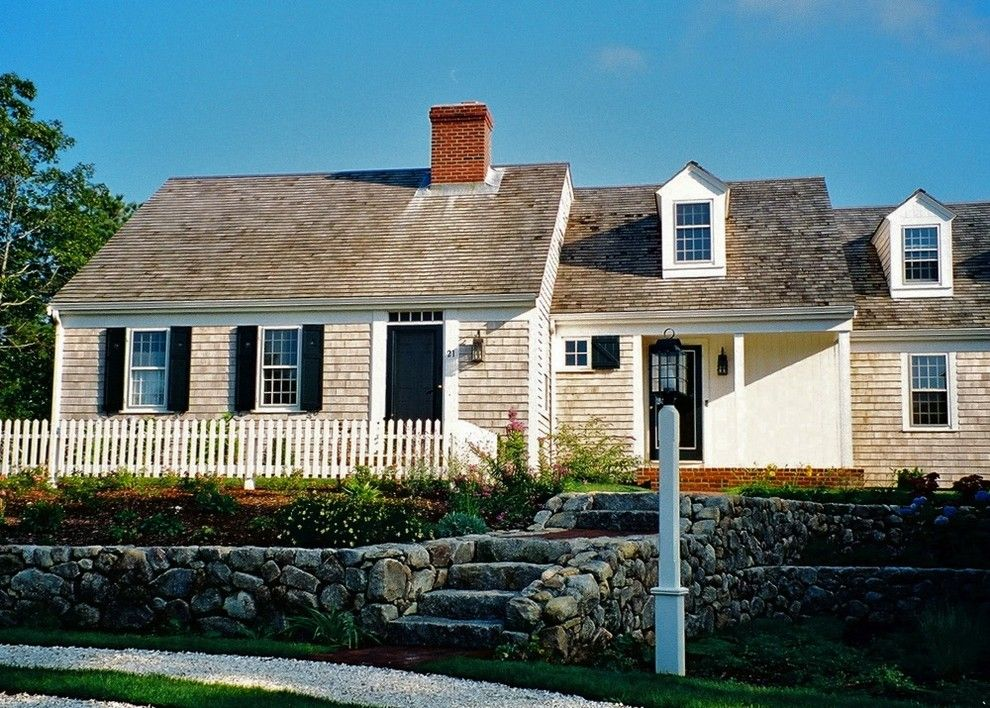 Clapboard for a Traditional Exterior with a Entry and Mill Pond House by Joseph B Lanza Design + Building