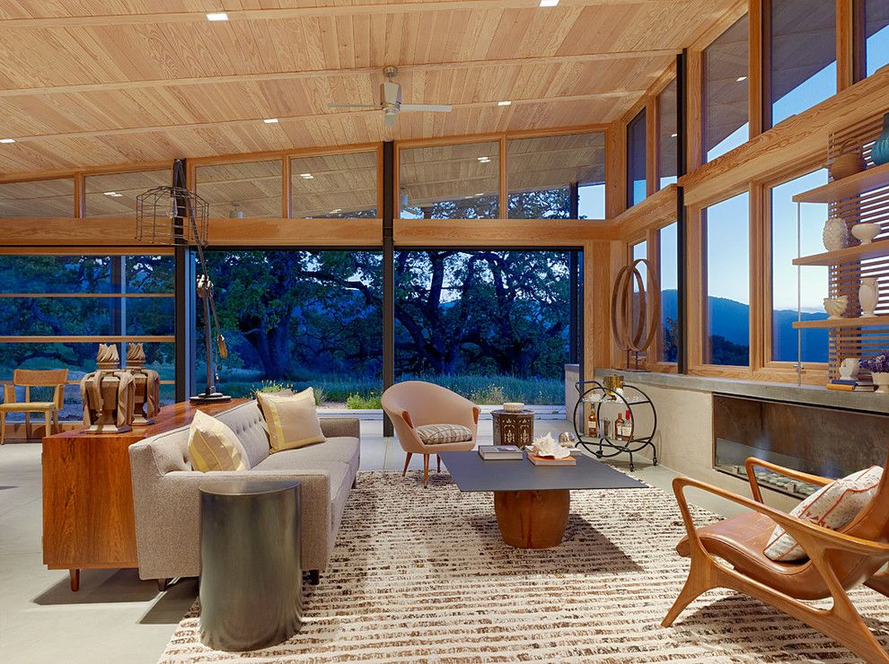 Clerestory Windows for a Contemporary Family Room with a Wood Ceiling and Caterpillar House by Feldman Architecture, Inc.