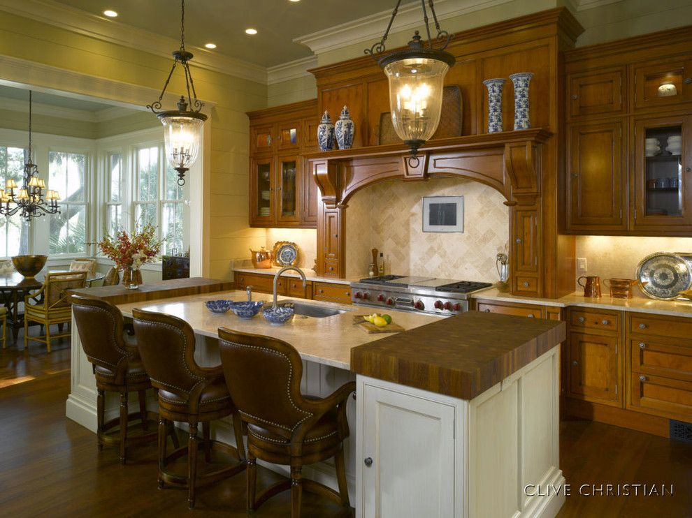 Clive Christian Kitchen for a Traditional Kitchen with a Traditional and Clive Christian Kitchen in Antique Yew Wood by Hungeling Design, Llc