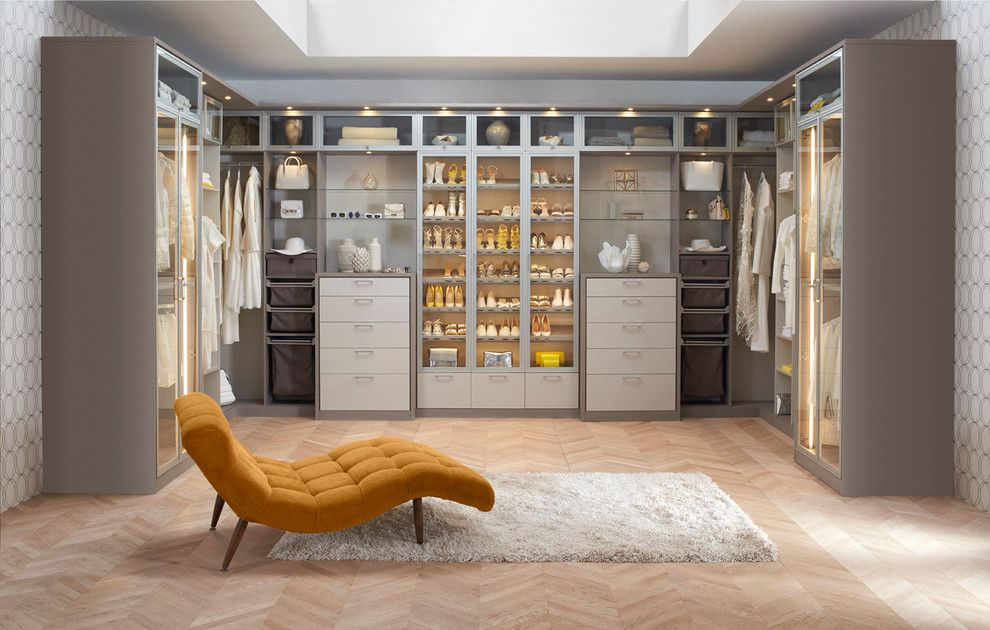 Closet Rod Height for a Contemporary Bedroom with a Herringbone Wood Floor and California Closets by California Closets Hq