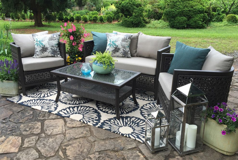 Clovis Glass for a  Patio with a Blue Pillow and Ae Outdoor by Ae Outdoor