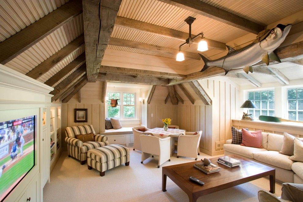 Cobblestone Wall for a Traditional Family Room with a Wood Ceiling and Robinson's Bay Residence by Murphy & Co. Design