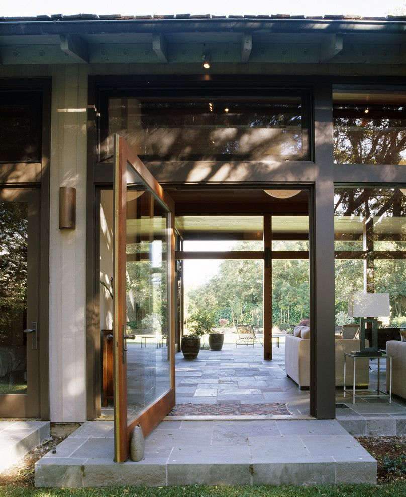 Codel Doors for a Modern Entry with a Table Lamp and Hillsborough Residence by Charlie Barnett Associates