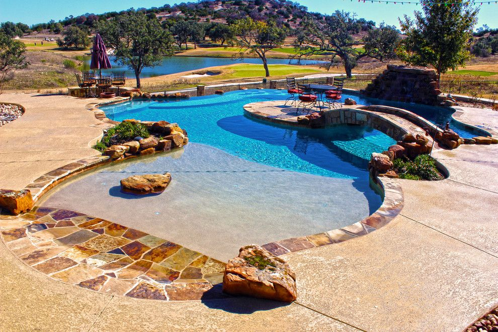 Cody Pools for a Contemporary Pool with a Tanning Ledge and Luxury Backyards by Cody Pools, Inc.