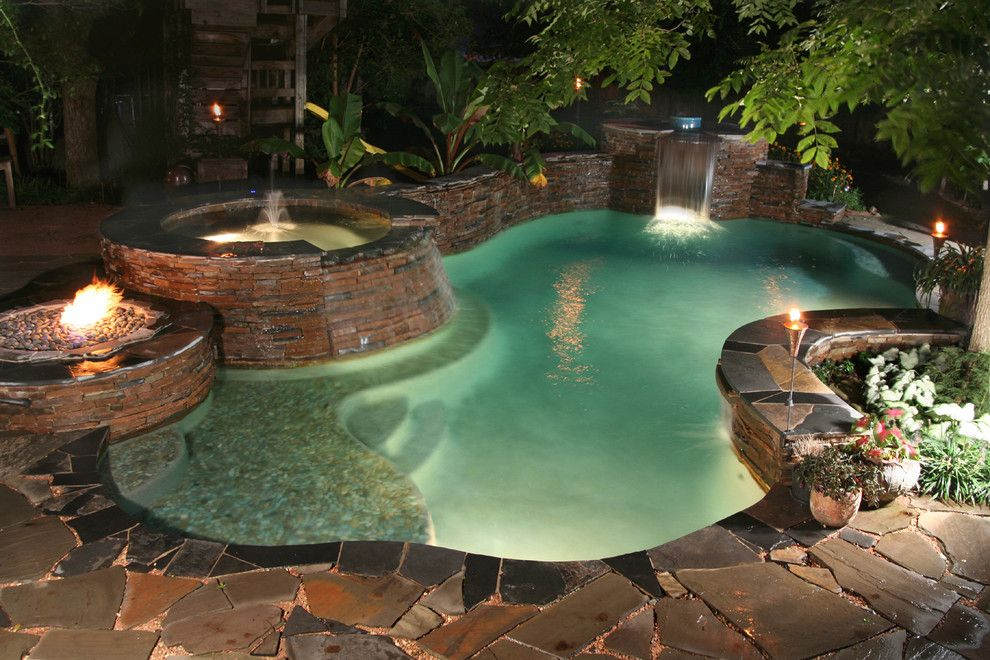 Cody Pools for a Traditional Pool with a Fire Pit and Luxury Backyards by Cody Pools, Inc.