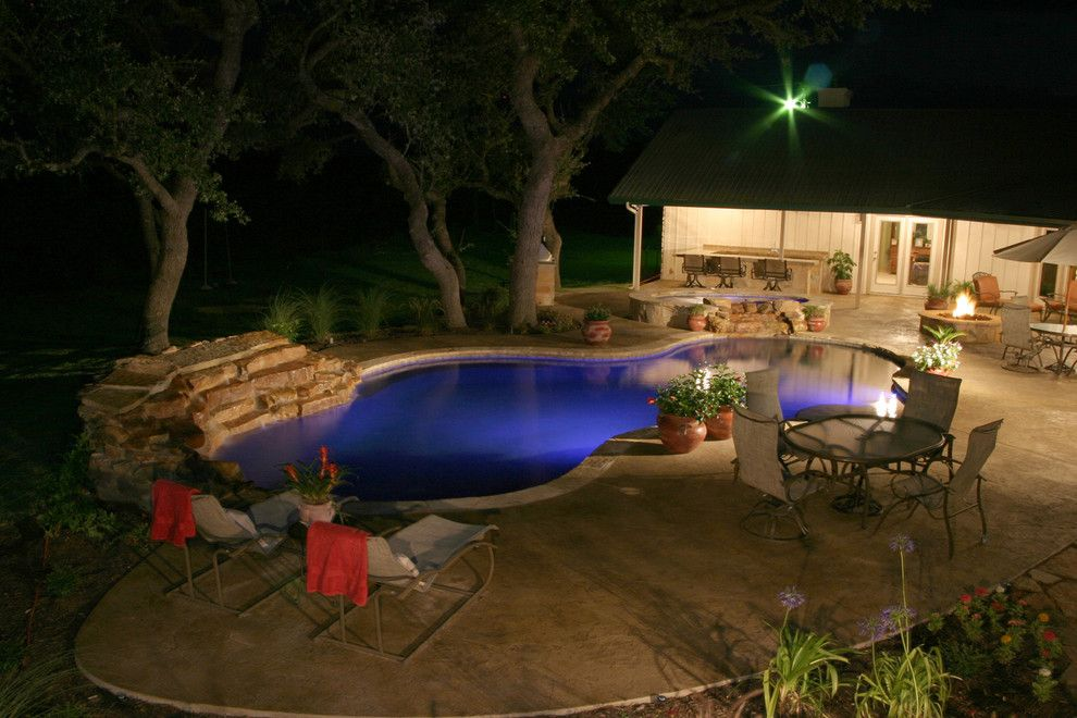 Cody Pools for a Traditional Pool with a Spa and Luxury Backyards by Cody Pools, Inc.