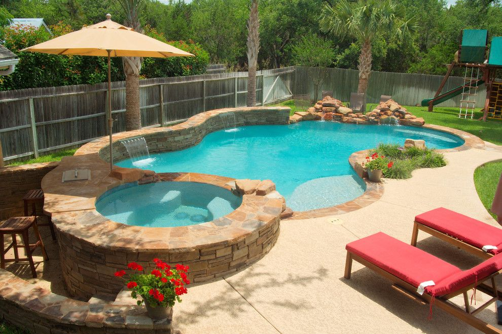 Cody Pools for a Traditional Pool with a Sundeck and Luxury Backyards by Cody Pools, Inc.