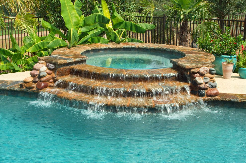 Cody Pools for a Traditional Pool with a Tiered Spa and Luxury Backyards by Cody Pools, Inc.