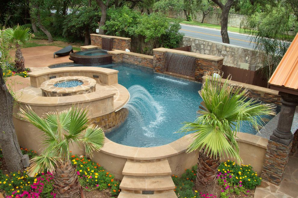 Cody Pools for a Traditional Pool with a Water Sheer and Luxury Backyards by Cody Pools, Inc.