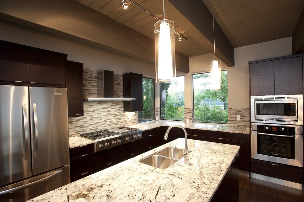 Cold Spring Granite for a Modern Kitchen with a Tile Backsplash and Kitchen by Frontporch