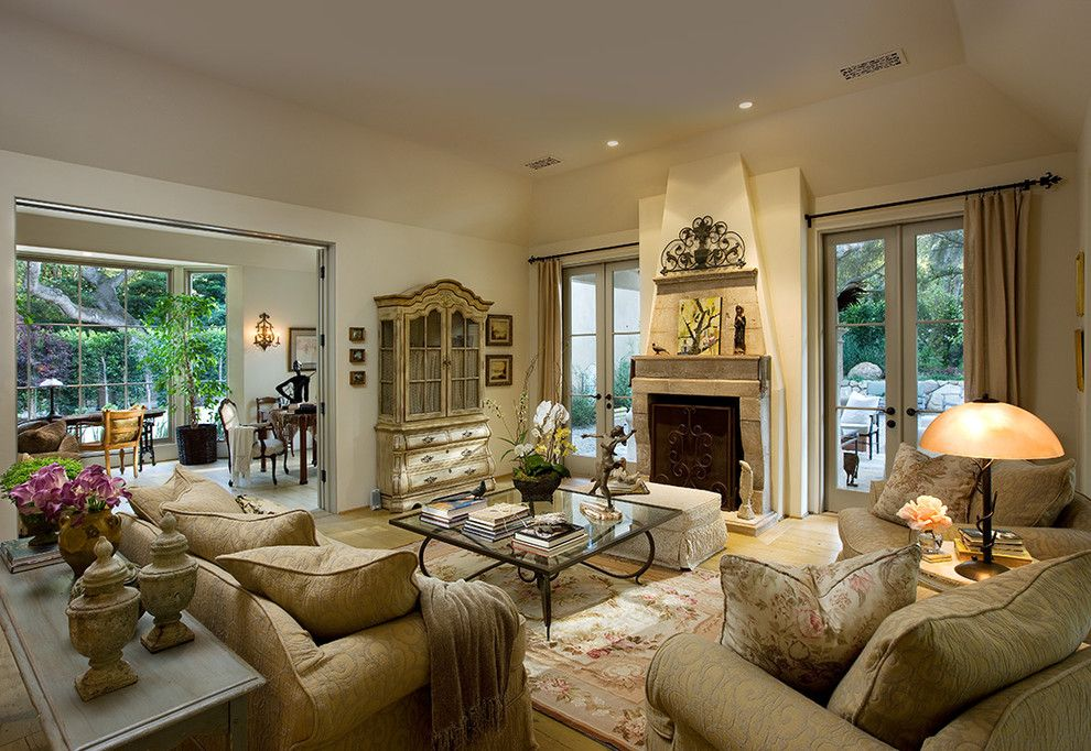 Coleman Furniture Reviews for a Mediterranean Living Room with a Window Treatments and Olive Mill by J. Grant Design Studio