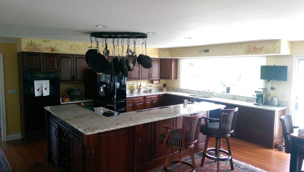 Colonial Gold Granite for a Mediterranean Spaces with a Raised Bar Countertops and Colonial Gold Granite Project by Granite Works Countertops