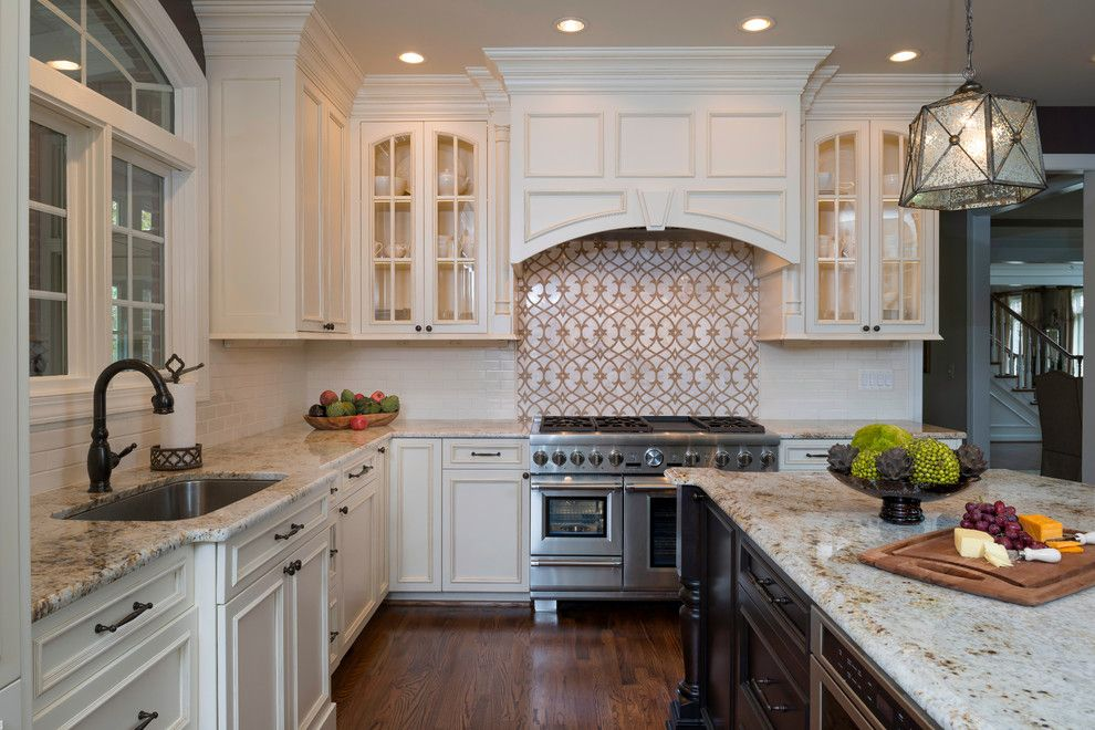 Colonial Gold Granite for a Traditional Kitchen with a Wood Hood and Leesburg River Creek Kitchen by Kim Kendall Interiors