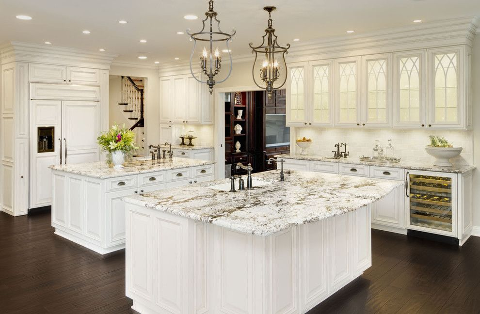 Colonial White Granite for a Traditional Kitchen with a Kitchen Hardware and Kitchen by Kanncept Design, Inc.