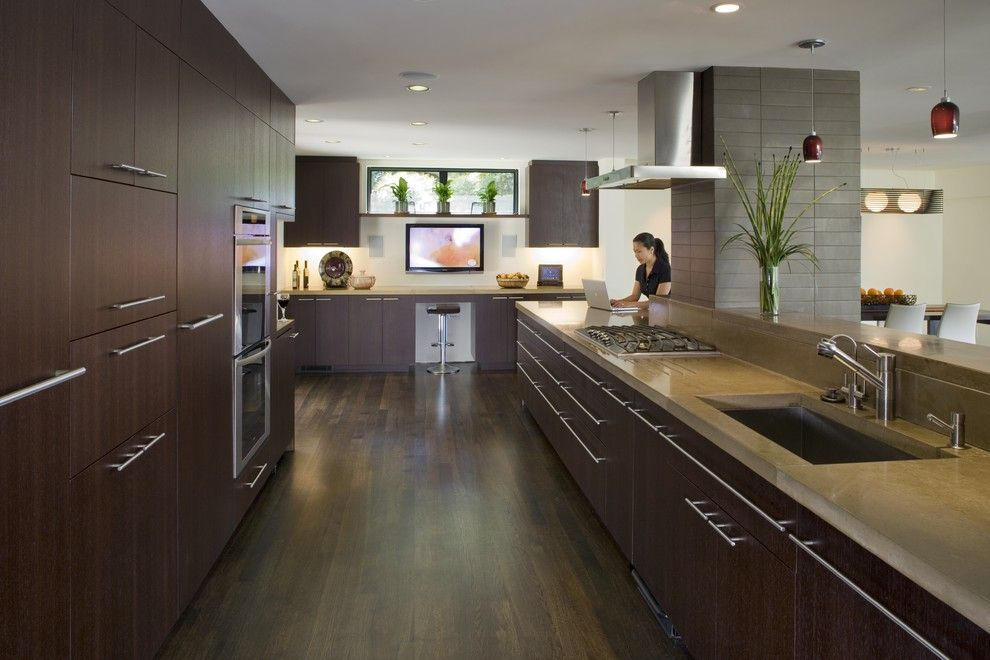Concrete Countertop Solutions for a Contemporary Kitchen with a Stainless Steel Appliances and Kitchen by Camber Construction