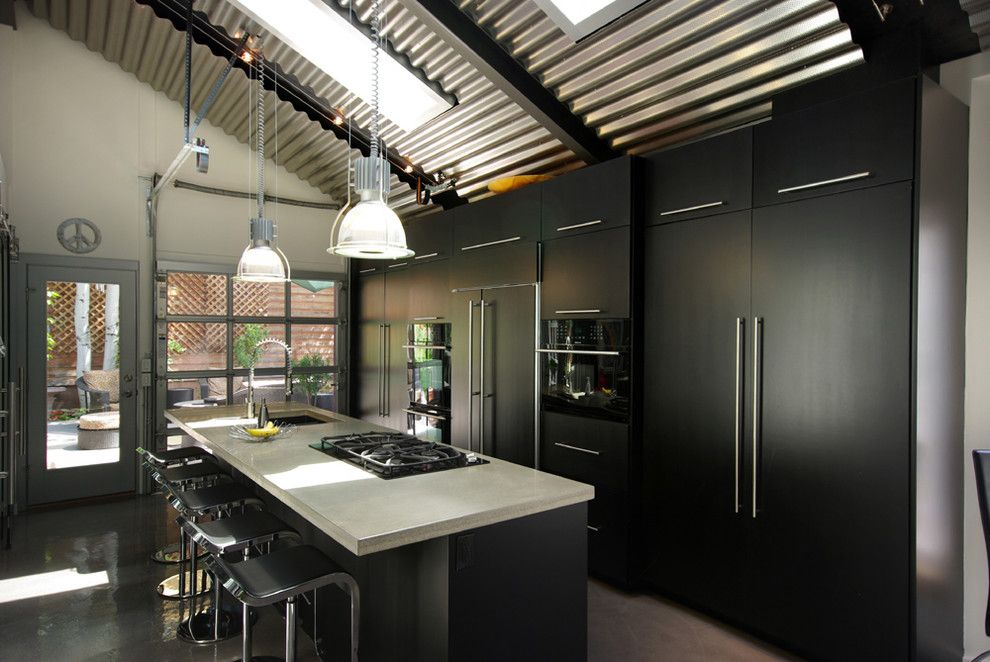 Concrete Countertop Solutions for a Industrial Kitchen with a Black Kitchen and Contemporary Black Kitchen with Concrete Counters and Stainless Steel Fixtures by Renovation Design Group