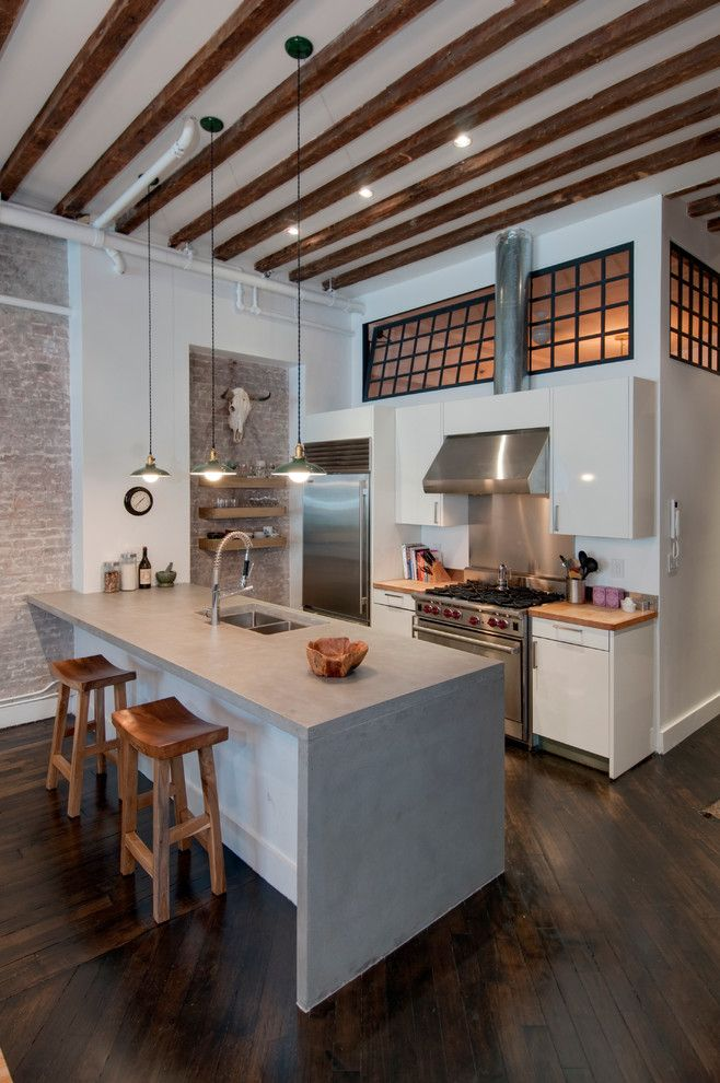 Concrete Countertop Solutions for a Industrial Kitchen with a Exposed Brick and Reiko Feng Shui Interior Design   Loft Renovation by Reiko Feng Shui Design