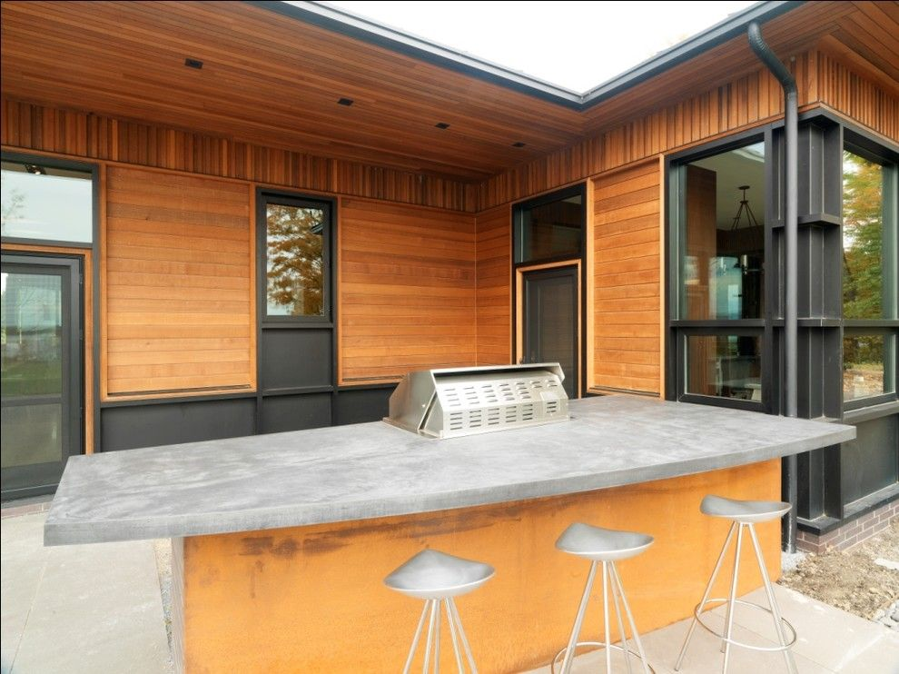 Concrete Countertop Solutions for a Rustic Patio with a Concrete Paving and Quaker Bluff Residence by Birdseye Design