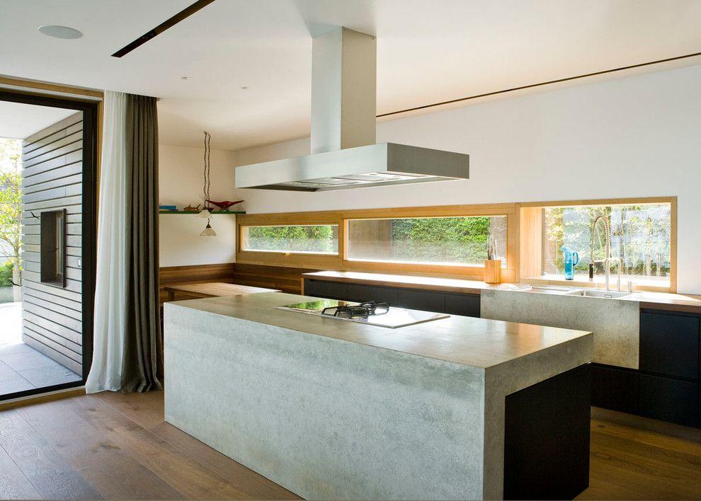 Concrete vs Asphalt for a Contemporary Kitchen with a Eiche and Küche Beton by Wiedemann Werkstätten