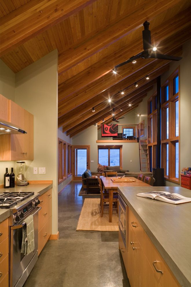 Concrete vs Asphalt for a Contemporary Kitchen with a Wood Ceiling Beams and Contemporary Kitchen by Lawrencearchitecture.com