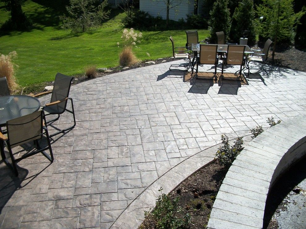 Concrete vs Asphalt for a Traditional Patio with a Stamped Concrete Patio and Ashler Slate Stamped Concrete Patio by Fordson Concrete