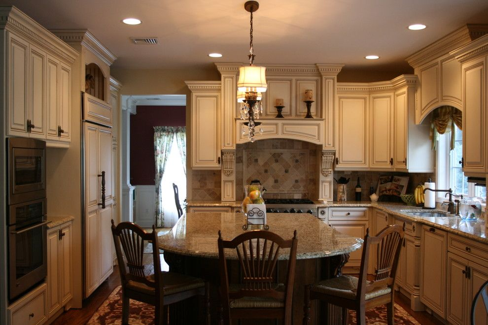 Conestoga Cabinets for a Traditional Kitchen with a Breakfast Bar and English Country Kitchen by Judy