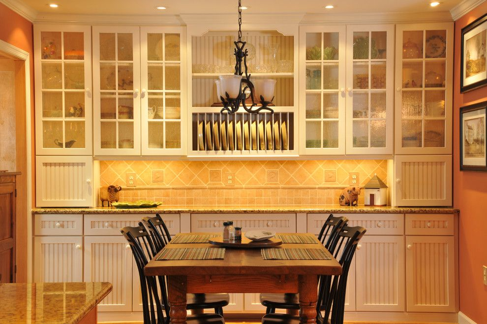 Conestoga Cabinets for a Traditional Kitchen with a Wood Cabinets and Dining Room Custom Installation by Julie Fifield