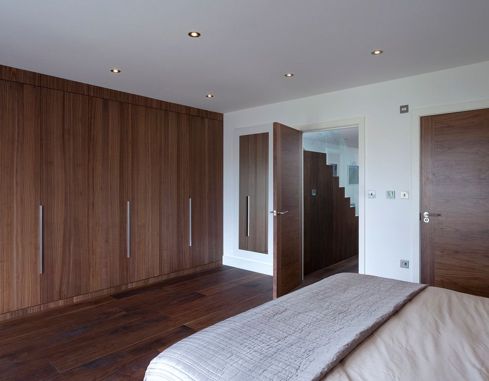 Contractors Wardrobe for a Contemporary Bedroom with a Built in Storage and Kempton House by Locksley Architects