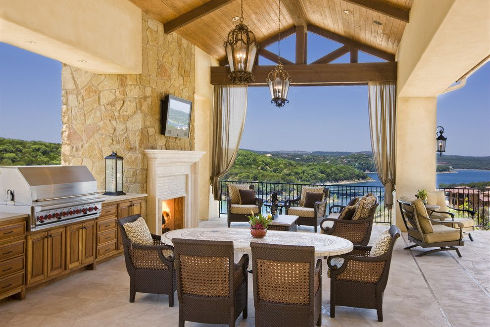 Copenhagen Furniture Austin for a Mediterranean Patio with a Outdoor Dining and Rough Hollow Outdoor Living by Cornerstone Architects