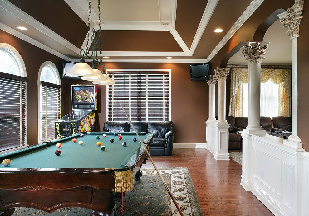 Corinthian Column for a Traditional Family Room with a Arch and Game Room by Creative Design Construction, Inc.