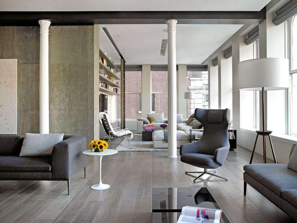 Corinthian Columns for a Contemporary Living Room with a Gray Couch and Bond Street Loft by Axis Mundi