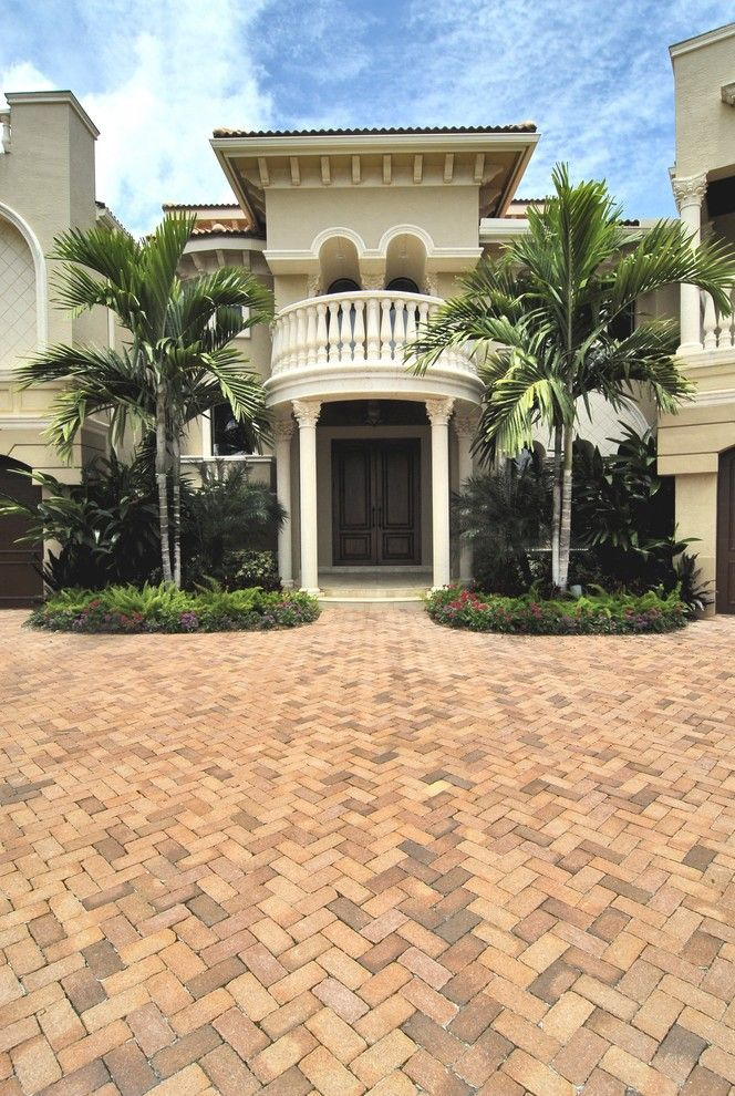Corinthian Columns for a Mediterranean Exterior with a Beige Stucco Exterior and Intracoastal Images by Gregory A. Jones Architecture