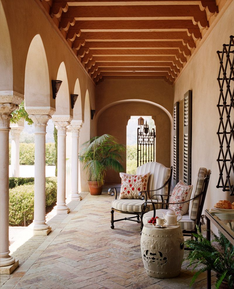 Corinthian Columns for a Mediterranean Porch with a Patio Chairs and Hilltop Villa by Tucker & Marks