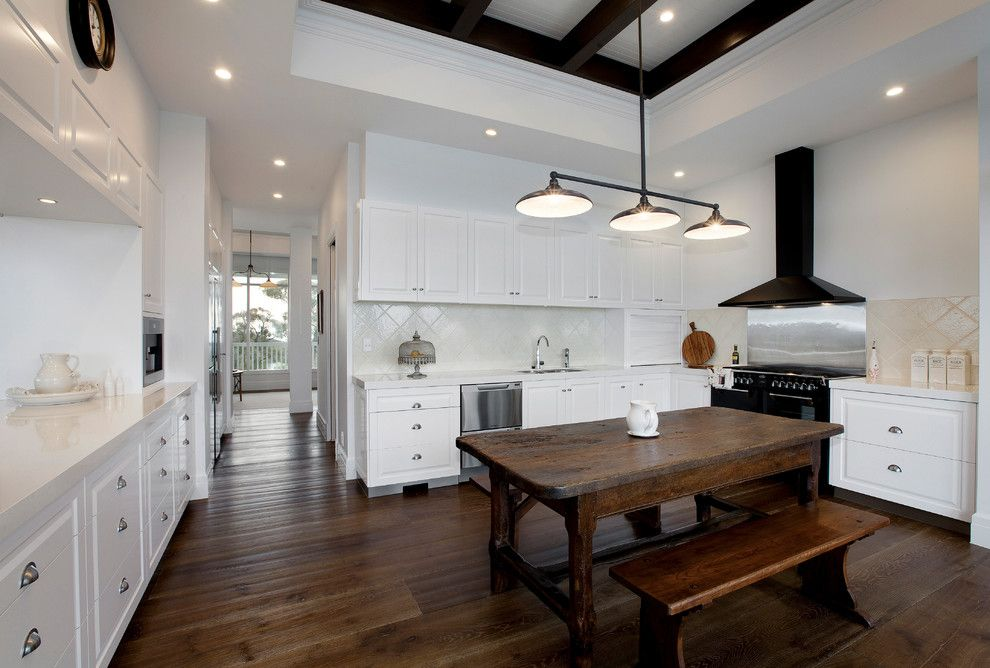 Cort Clearance Furniture for a Farmhouse Kitchen with a Dark Wood Ceiling Beams and Bowrings by Vibe Design Group