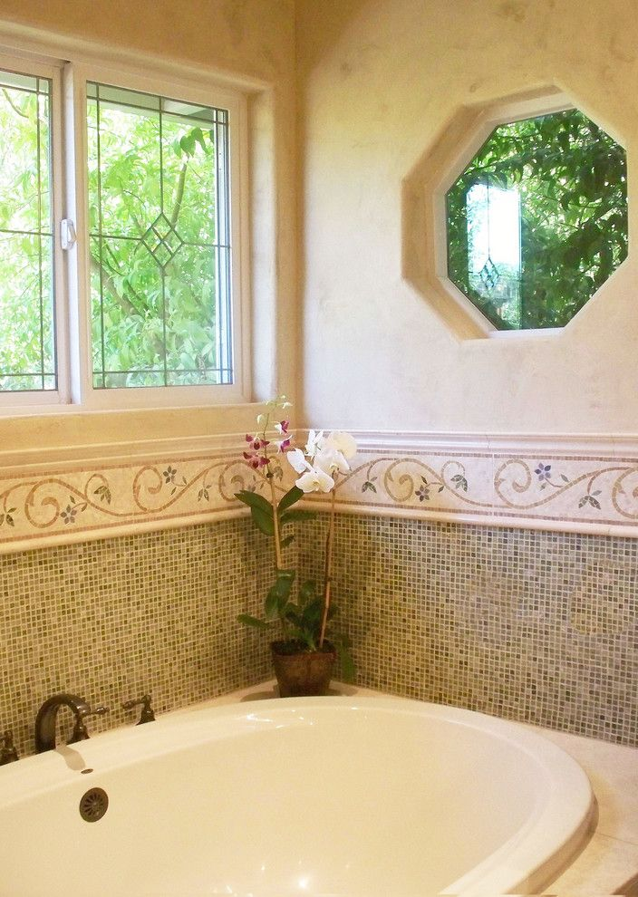 Cosa Marble for a Traditional Bathroom with a Limestone Bathroom and Ming Green Marble Master Bath Remodel by Plc Interiors