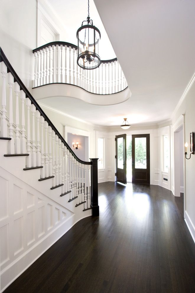Cost to Refinish Hardwood Floors for a Traditional Entry with a Wooden Staircase and Award Winning Stair Hall and Entry Foyer by Clawson Architects, Llc