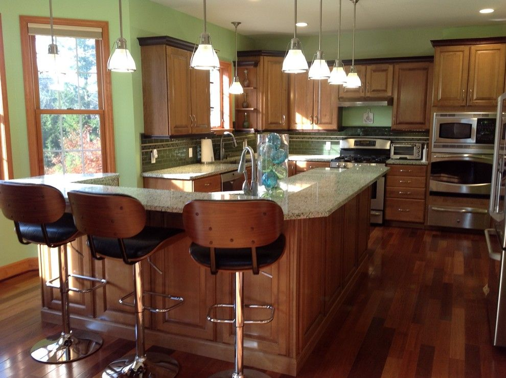 Costco Cabinets for a Eclectic Kitchen with a Wine Refrigerator and Vetrazzo Island by Avalon Kitchen