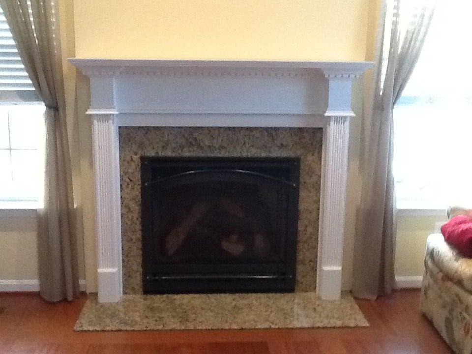 Courtland Hearth for a  Spaces with a Fireplace Mantels and Finished Installs by Courtland Hearth & Hardware