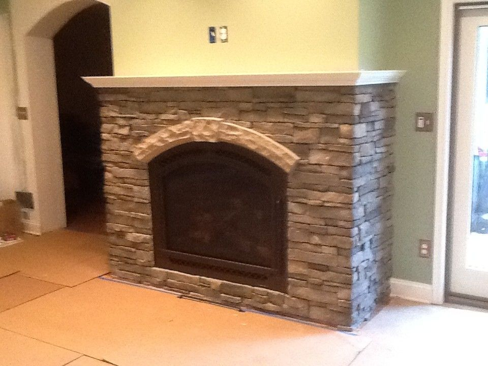 Courtland Hearth for a  Spaces with a Stone Work and Finished Installs by Courtland Hearth & Hardware