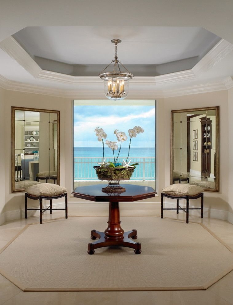 Coved Ceiling for a Beach Style Living Room with a Tile Flooring and Intrinsic Designs Portfolio by Jill Shevlin Design