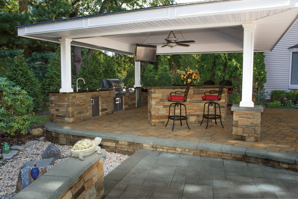 Coved Ceiling for a Contemporary Spaces with a Outdoor Bar and Cambridge Pavingstones with Armortec by Cambridge Pavingstones with Armortec