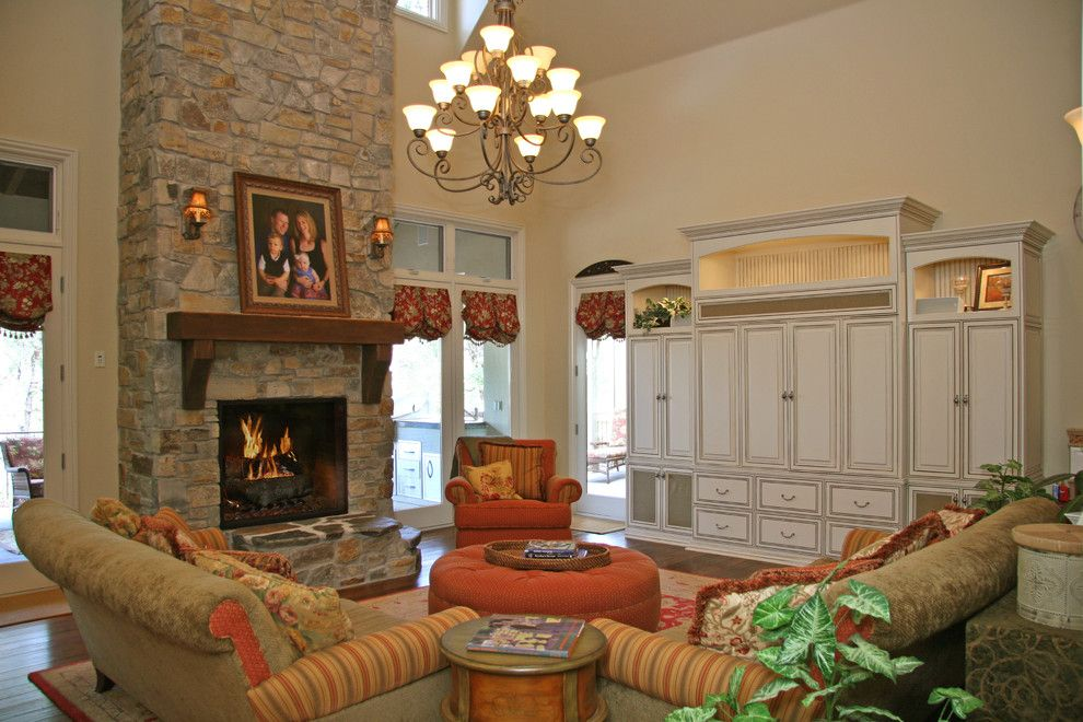 Craftmaster Doors for a Rustic Family Room with a Chenille Sofa and Landmark Builders by Landmark Builders