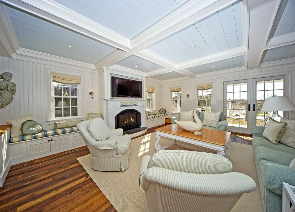 Craftmaster Doors for a Traditional Family Room with a Area Rug and Family Room by Archia Homes