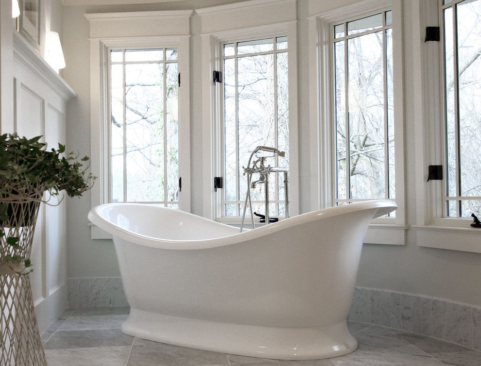 Craftsman Window Trim for a Traditional Bathroom with a Freestanding Bathtub and Arts & Crafts Bathroom by Dresser Homes