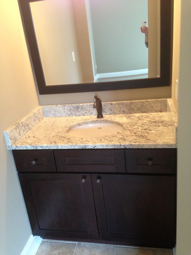 Crema Pearl Granite for a Traditional Bathroom with a Lighting and 2013 Parade of Homes by Knoxville's Stone Interiors