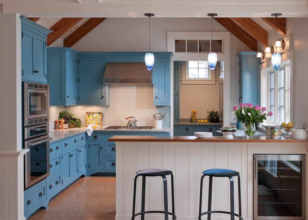 Crown Point Cabinetry for a Beach Style Kitchen with a Open Kitchen and Beautiful Blue Waterfront Cottage, Martha'S Vineyard by Elizabeth Swartz Interiors