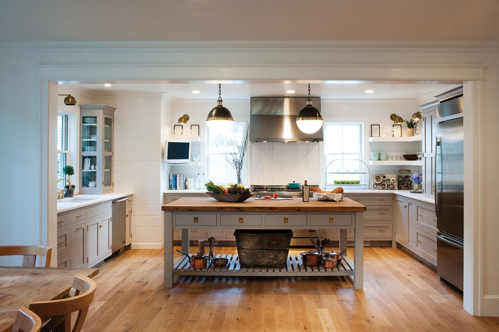 Crown Point Cabinetry for a Farmhouse Kitchen with a Unlaquered Brass Hardware and Farmhouse Kitchen with a Mid-Century Twist by Crown Point Cabinetry