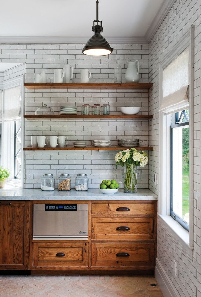 Crown Point Cabinetry for a Rustic Kitchen with a Gray Grout and Rustic Reclaimed Chestnut by Crown Point Cabinetry