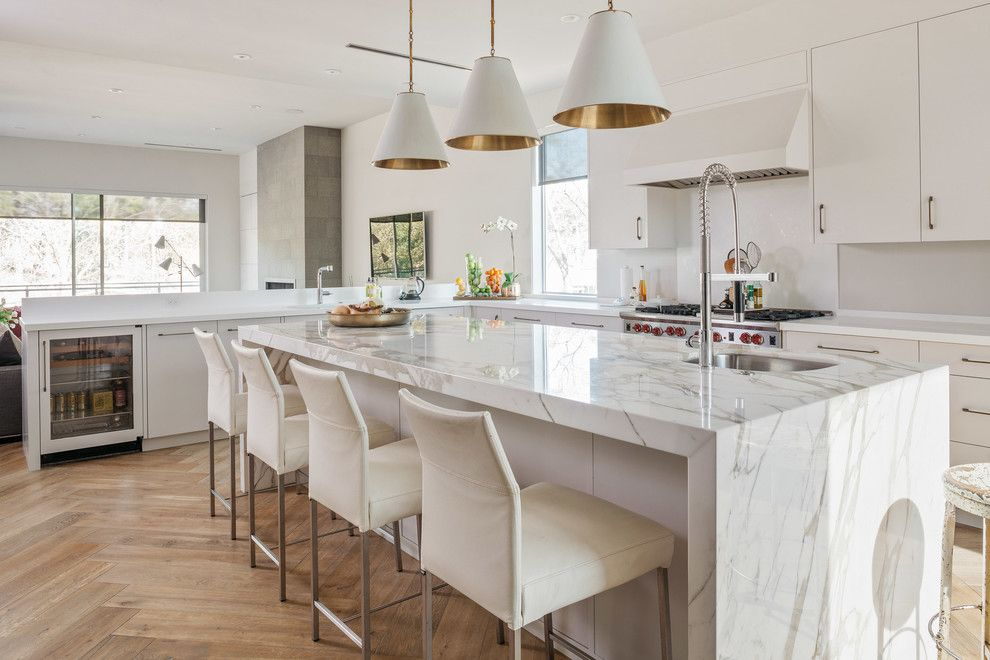 Csl Lighting for a Contemporary Kitchen with a Herringbone Wood Floor and Urban Modern by Poet Interiors