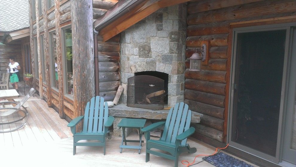 Cuddledown for a Rustic Deck with a Maine and Fireplace & Adirondack Chairs by Cuddledown